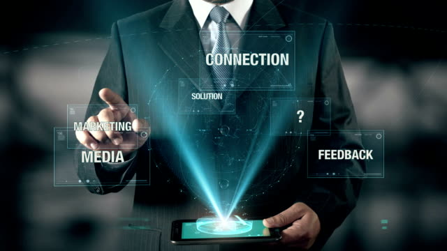 Businessman with Communication concept choose from Solution Marketing Feedback Media Connection using digital tablet video