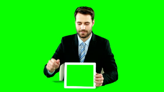 Businessman with digital tablet touching digital screen video