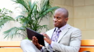 Businessman with digital tablet video