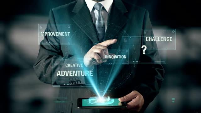 Businessman with Entrepreneurship concept choose from Innovation Creative Challenge Improvement Adventure using digital tablet video