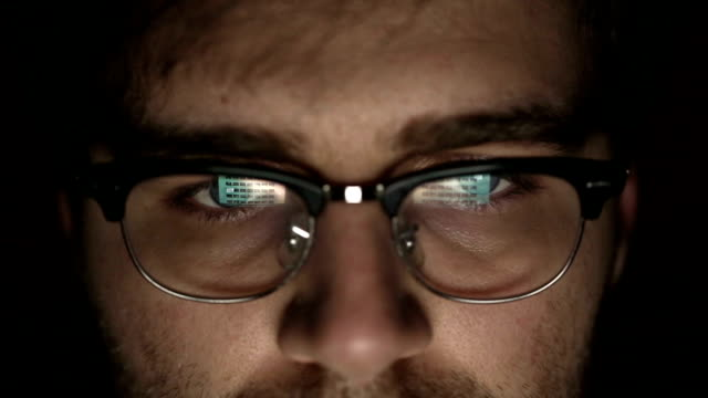 Businessman with glasses who works at night. Close up video