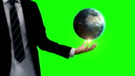 Businessman with globe animation in front of green screen video