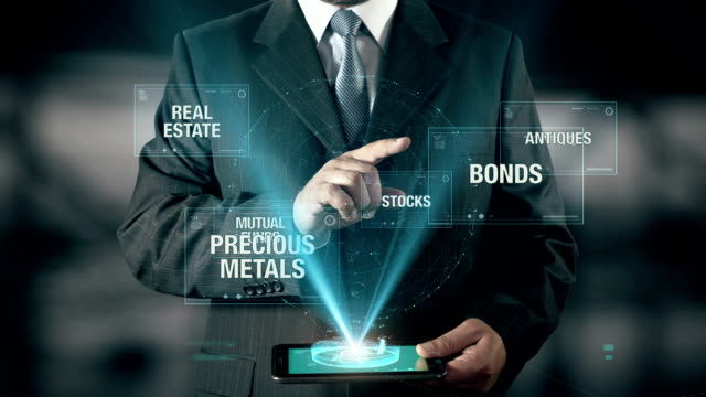 Businessman with Investment concept choose Bonds from Funds Antiques Metals Stocks Real Estate using digital tablet video