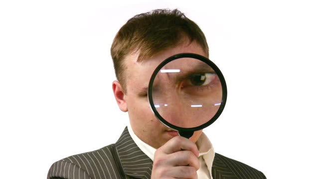Businessman with magnifier face video