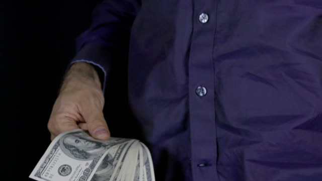Businessman with pack of money in slow motion video