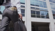 Businessman with pocket full of money video