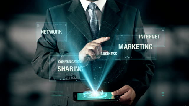 Businessman with Social Media concept choose Marketing from Business Communication Internet Network Sharing using digital tablet video