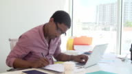 Businessman Working At Desk In Design Studio video