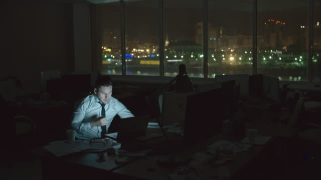 Businessman Working at Night Office video