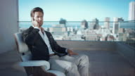 Businessman working in penthouse video