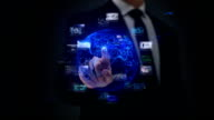 Businessman working on a futuristic holographic interface. Touchscreen. Digital Tablet. video