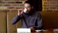 Businessman working on digital tablet at cafe video