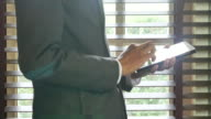 Businessman working on digital tablet in the evening video