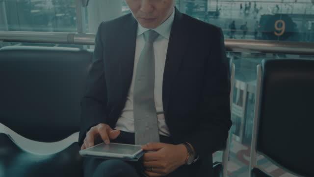 Businessman working on digital tablet video