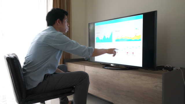 Businessman working on financial data with touch screen video