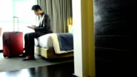 Businessman working on laptop and smartphone in the hotel video