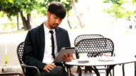 Businessman working on tablet computer video
