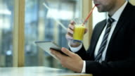 Businessman Working on Tablet in Caffee video