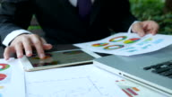 Businessman working on the tablet with diagrams video