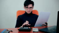 Businessman working with financials, budget, using calculator, counting money video