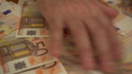 Businessman's hands laying out money on the table video