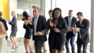 Businessmen And Businesswomen Dancing In Office Lobby video