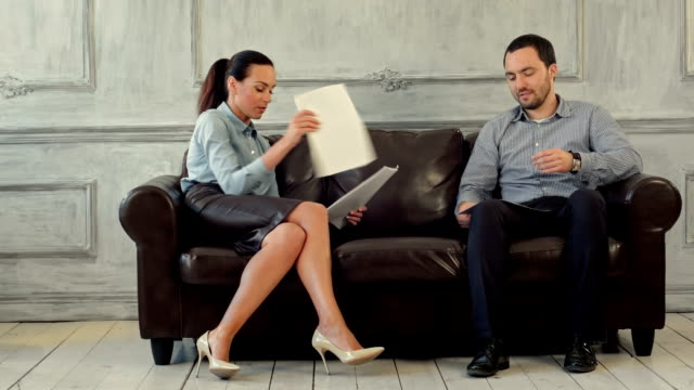 Businessmen and woman discussing in the office with documents video