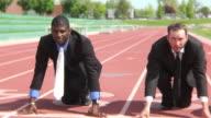 Businessmen at starting line video