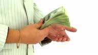 Businessmen counting money hundred dollar bills video