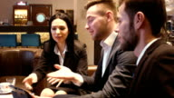 businessmen discuss papers video