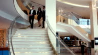 Businessmen go down on steps and communicate video