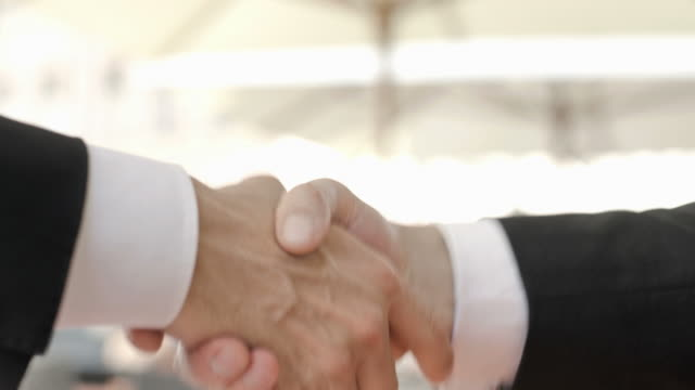 HD: Businessmen Handshaking Outdoors video