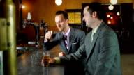 Businessmen having conversation in bar video