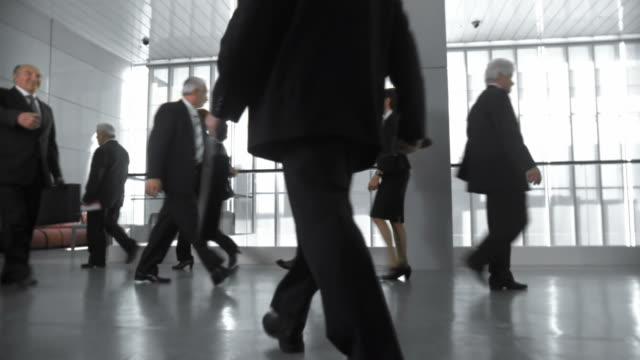 HD DOLLY: Businessmen Meet In Busy Corridor video