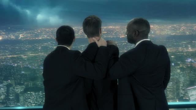 Businessmen overlooking city video