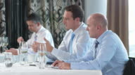 HD DOLLY: Businessmen Reviewing Results During Lunch video