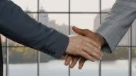Businessmen shake hands in headquarters. video