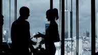 Businessmen shaking hands video