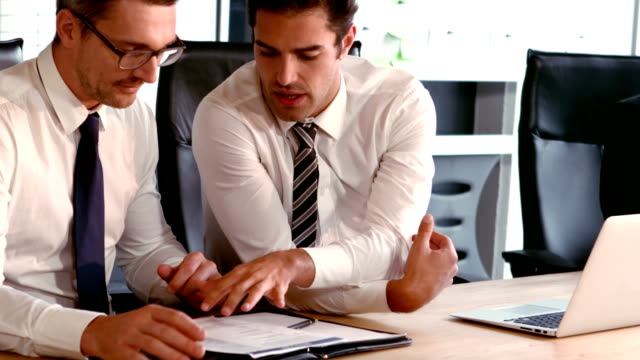 Businessmen talking about documents video