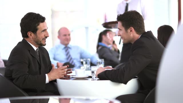 HD DOLLY: Businessmen Talking During Coffee Break video