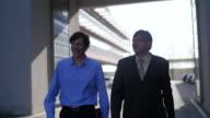 Businessmen walking outdoor video