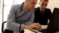 Businessmen working using laptop video