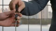 Businessmen's hands pass car key. video
