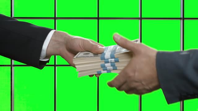Businessmen's hands pass money. video