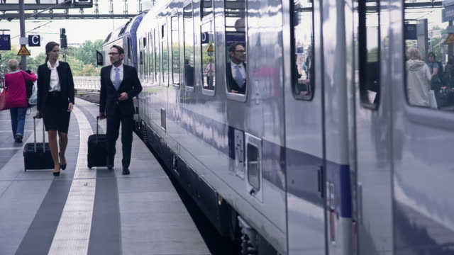 Businesspeople at station video