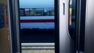 Businesspeople boarding train video