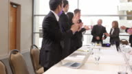 Businesspeople clapping during presentation video