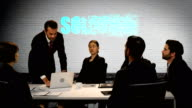Businesspeople discussing in meeting video