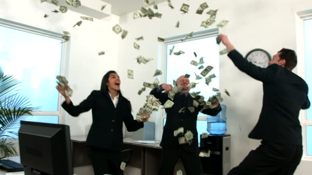 Businesspeople in office throwing money video