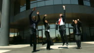 Businesspeople jumping and cheering, slow motion video